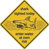 9963905-grunge-shark-attack-warning-sign-vector-eps8