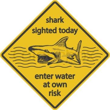 9963905-grunge-shark-attack-warning-sign-vector-eps8